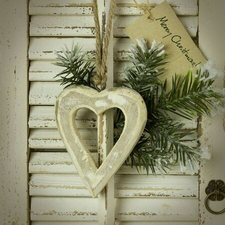 Christmas decoration hanging over rustic wooden background Stock Photo