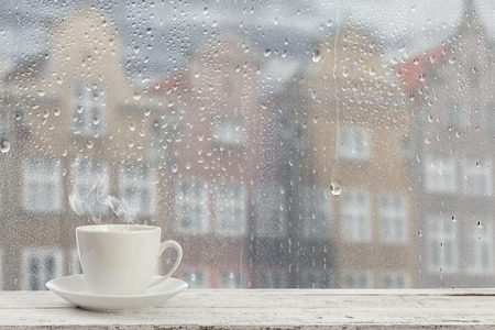 coffee cup on a rainy day window background
