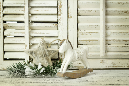antik: wooden rocking horse on a wooden rustic background