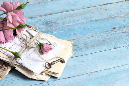 old letters: pink rose,  heart and old letters on romantic blue background