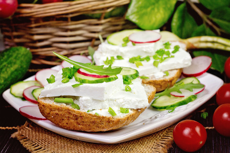 rukola: bread with curd cheese and chives.Shallow depth of field