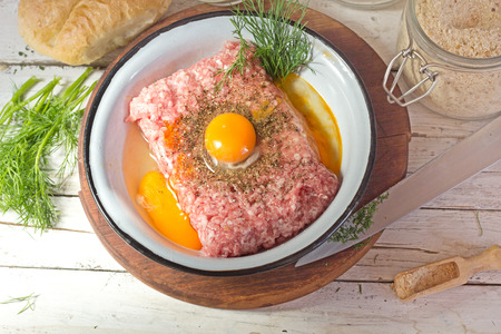 butcher s shop: minced meat with raw egg Stock Photo