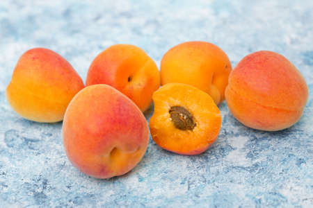 apricot kernels: Fresh ripe apricots on a turquoise background