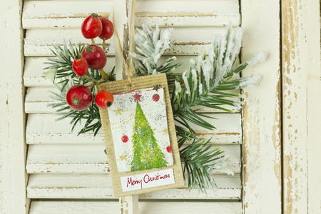 antique sleigh: Christmas decoration hanging over rustic wooden background Stock Photo