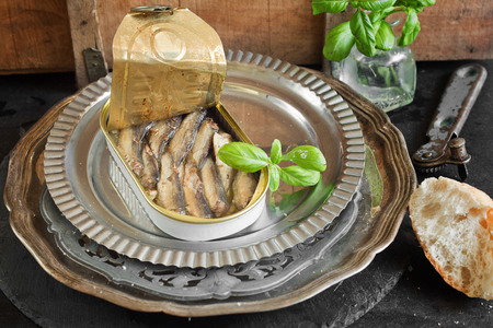 canned goods: Open tin can with sardines Stock Photo