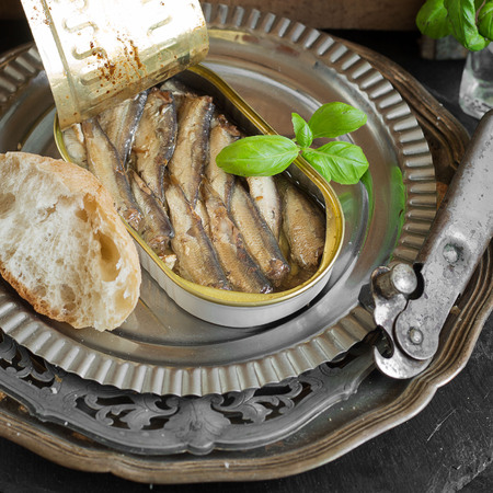 Open tin can with sardines Stock Photo