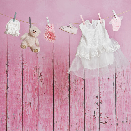 clean clothes: Baby clothes hanging on the clothesline