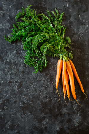 Fresh carrots on a black background