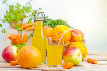 friuts juice in glass and vegetables beside Stock Photo