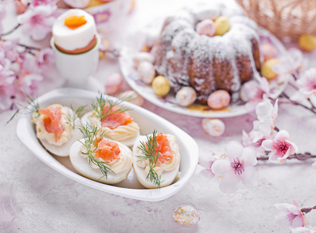 Easter cake and  eggs with salmon