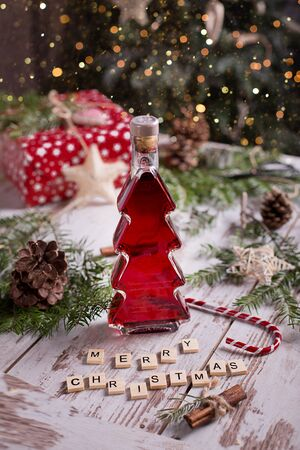 red wine in a Christmas tree-shaped bottle