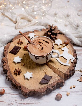 Christmas hot chocolate, decor with nuts, spices