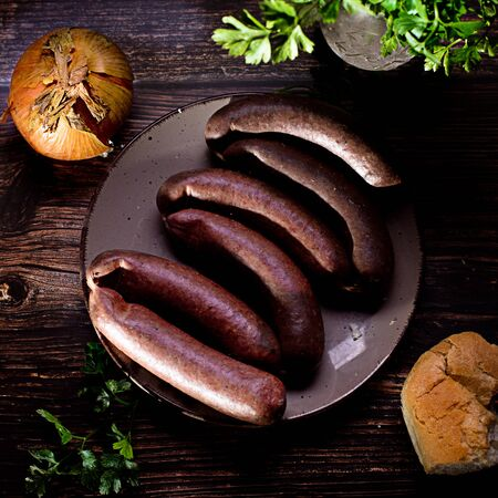 blood sausage with onion and parsley