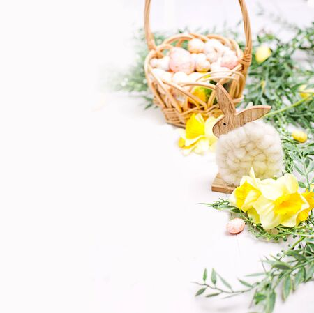 Easter background with eggs and flowers. Template for text