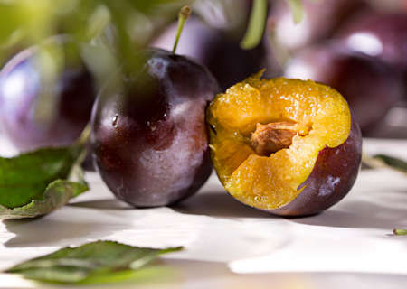 Blue violet fruit background with ripe tasty sweet plums from garden