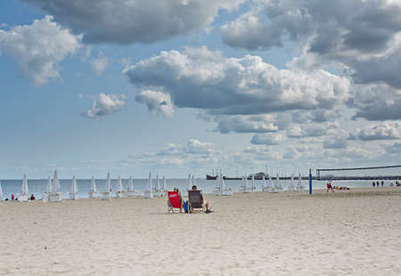 Poland, Sopot, september 13, 2020. People walking on summer day in the beach