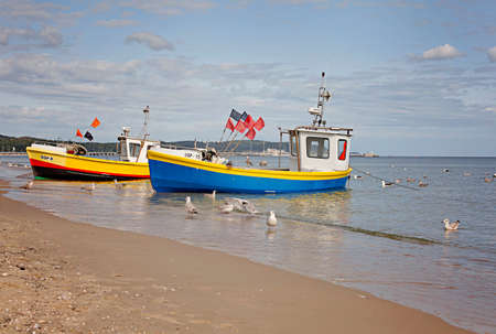 Colorful boat to go fishing with small colorful flags, Sopot, Poland 免版税图像 - 155302898
