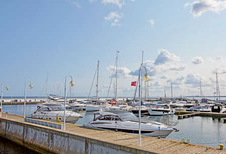 SOPOT, POLAND - october 13, 2020: Sail boats and yachts docked at the marina (harbor) in the Pier Molo, the longest wooden pier in Europe, at the baltic sea. 新聞圖片