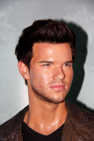 London, - United Kingdom, 08, July 2014. Madame Tussaud's in London.  Waxwork statue of Taylor Lautner . Created by Madam Tussaud's in 1884, Madam Tussaud's is a waxwork museum and tourist attraction. 報道画像