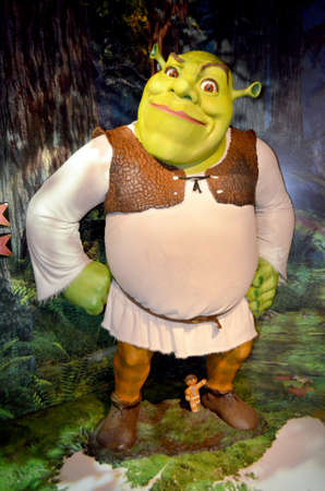 London, - United Kingdom, 08, July 2014. Madame Tussaud's in London.  Waxwork statue of Shrek. Created by Madam Tussaud's in 1884, Madam Tussaud's is a waxwork museum and tourist attraction.