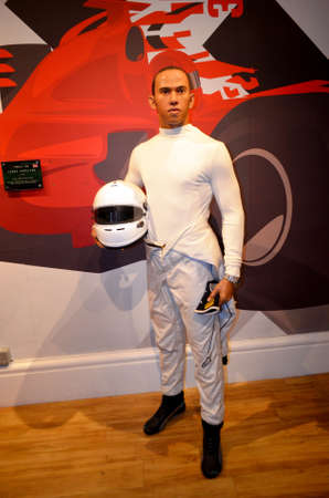 London, - United Kingdom, 08, July 2014. Madame Tussauds in London.  Waxwork statue Lewis Hamilton. Created by Madam Tussauds in 1884, Madam Tussauds is a waxwork museum and tourist attraction.