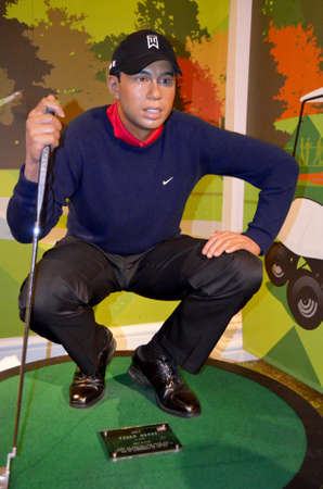 London, - United Kingdom, 08, July 2014. Madame Tussauds in London.  Waxwork statue of Tiger Woods, Created by Madam Tussauds in 1884, Madam Tussauds is a waxwork museum and tourist attraction