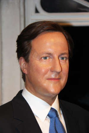 London, - United Kingdom, 08, July 2014. Madame Tussaud's in London.  Waxwork statue of David Cameron  . Created by Madam Tussaud's in 1884., Madam Tussaud's is a waxwork museum and tourist attraction.