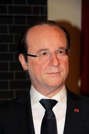 London, - United Kingdom, 08, July 2014. Madame Tussauds in London.  Waxwork statue of François Hollande . Created by Madam Tussauds in 1884. Madam Tussauds is a waxwork museum and tourist attraction