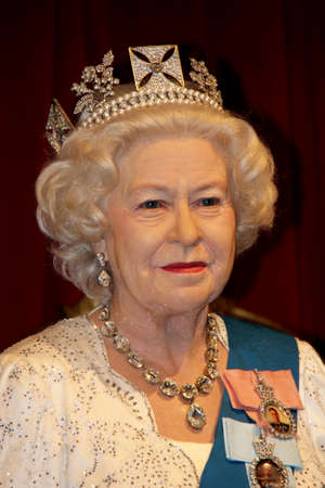 London, - United Kingdom, 08, July 2014. Madame Tussauds in London. Waxwork statue of Queen Elizabeth II. Created by Madam Tussauds in 1884. Madam Tussauds is a waxwork museum and tourist attraction.