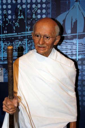 London, - United Kingdom, 08, July 2014. Madame Tussauds in London.  Waxwork statue of Mohandas Karamchand Gandhi. Created by Madam Tussauds in 1884, Madam Tussauds is a waxwork museum. 新闻类图片
