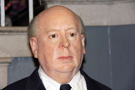 London, - United Kingdom, 08, July 2014. Madame Tussauds in London.  Waxwork statue of Alfred Hitchcock. Created by Madam Tussauds in 1884, Madam Tussauds is a waxwork museum and tourist attraction. 新闻类图片