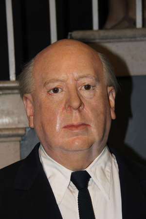 London, - United Kingdom, 08, July 2014. Madame Tussauds in London.  Waxwork statue of Alfred Hitchcock. Created by Madam Tussauds in 1884, Madam Tussauds is a waxwork museum and tourist attraction. Editorial
