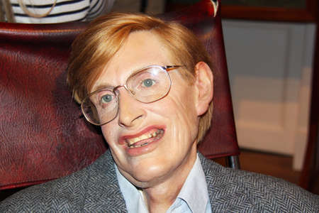 London, - United Kingdom, 08, July 2014. Madame Tussauds in London. Waxwork statue of Stephen Hawking. Created by Madam Tussauds in 1884, Madam Tussauds is a waxwork museum and tourist attraction.