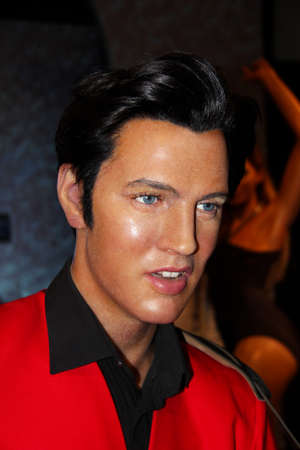 London, - United Kingdom, 08, July 2014. Madame Tussauds in London.  Waxwork statue of Elvis Presley. Created by Madam Tussauds in 1884, Madam Tussauds is a waxwork museum and tourist attraction