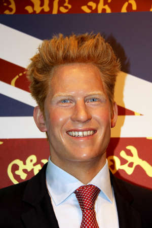 London, - United Kingdom, 08, July 2014. Madame Tussauds in London.  Waxwork statue of  Prince Harry. Created by Madam Tussauds in 1884, Madam Tussauds is a waxwork museum and tourist attraction.
