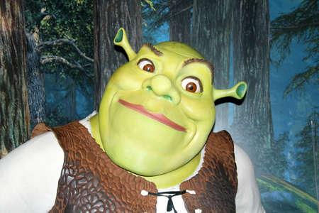 London, - United Kingdom, 08, July 2014. Madame Tussauds in London.  Waxwork statue of Shrek. Created by Madam Tussauds in 1884, Madam Tussauds is a waxwork museum and tourist attraction 新闻类图片