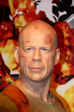 London, - United Kingdom, 08, July 2014. Madame Tussauds in London.  Waxwork statue of Bruce Willis. Created by Madam Tussauds in 1884, Madam Tussauds is a waxwork museum and tourist attraction