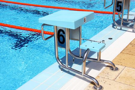 View of a diving board in a  pool