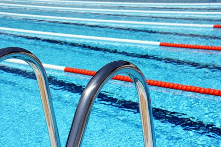 Swimming pool lane Ropes and ladder steps.