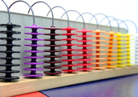 Image of a colorful old abacus