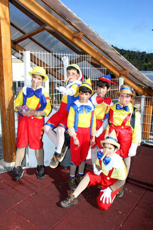 Monchique, Algarve, Portugal. CIrca February 2014. School children dressed up as Pinocchios for the annual carnival.   Pinocchio is a 1940 American animated film produced by  Disney and based on the story The Adventures of Pinocchio by Carlo Collodi 新聞圖片