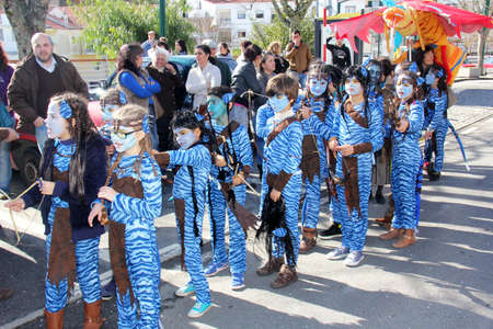 Monchique, Algarve, Portugal. Circa February 2014. School children dressed in Avatar costumes during Carnival in the streets of the mountain town of Monchique in Algarve Portugal.