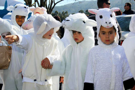 Monchique, Algarve, Portugal. Circa February 2014. School children dressed in sheep costumes during Carnival in the streets of the mountain town of Monchique in Algarve Portugal.