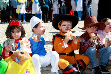 Monchique, Algarve, Portugal. Circa February 2014. School children dressed in costumes during Carnival in the streets of the mountain town of Monchique in Algarve Portugal.