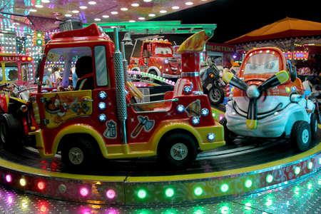 Portugal, Algarve, Portimao. Circa November 2017. Carousel cars ride in a carnival in Portugal.