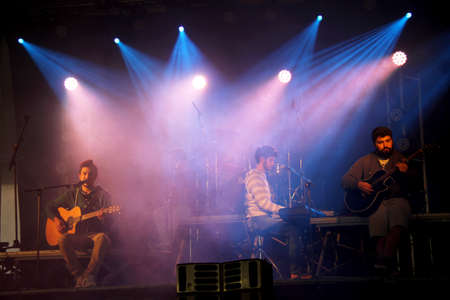 Monchique, Algarve, Portugal. Circa March 2016. Portuguese Band  Atoa playing in a traditional sausage  festival in Monchique.  Atoa are a Portuguese band who play rock and pop from the city of Evora.  Joao, Rodrigo and M 新聞圖片