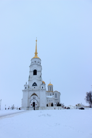 Winter view of the Belltower of the Dormition Cathedral in Vladimir (Russia) from the cathedral square in the cloudy day.