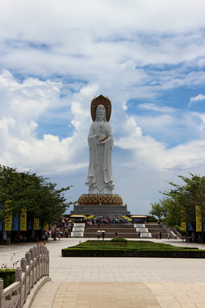 Sanya, Hainan, China - September 29, 2017: a crowd of Chinese tourists at the base of the statue of the goddess Guanyin in Nanshan Buddhist Cultural Centre