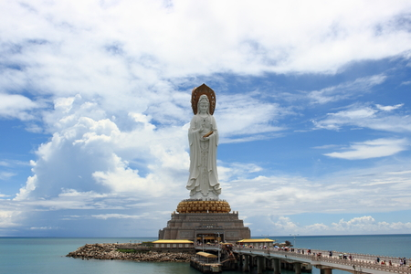 Sanya, Hainan, China - September 29, 2017: View from the square of Light on the statue of the goddess Guanyin located in the sea on an artificial island in Nanshan Buddhist Cultural Centre