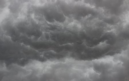 abstract stormy background from low heavy gray cumulus clouds